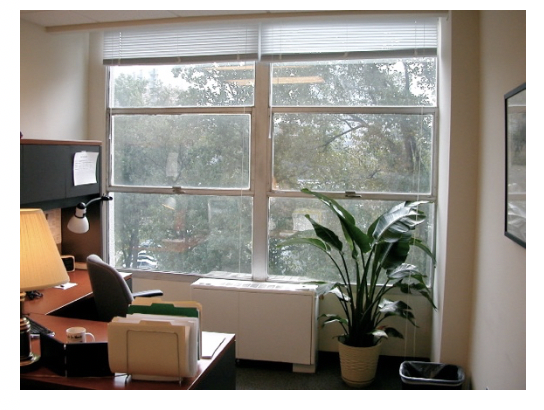 Figure 1 – Office with operable windows and view of trees (Source: Flickr drewsaunders http://www.flickr.com/photos/drewbsaunders/116533602/ ).